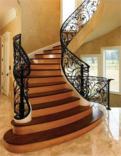 Best A Dramatic Curved Staircase Abuts An Outside Wall Adding 400 x 300