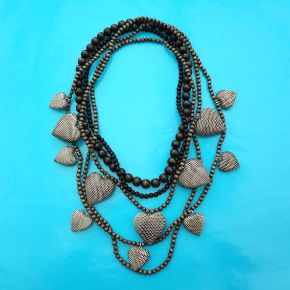 Necklace snake hearts, from the wood collection... more wood on http://inekeottejewelry.com/