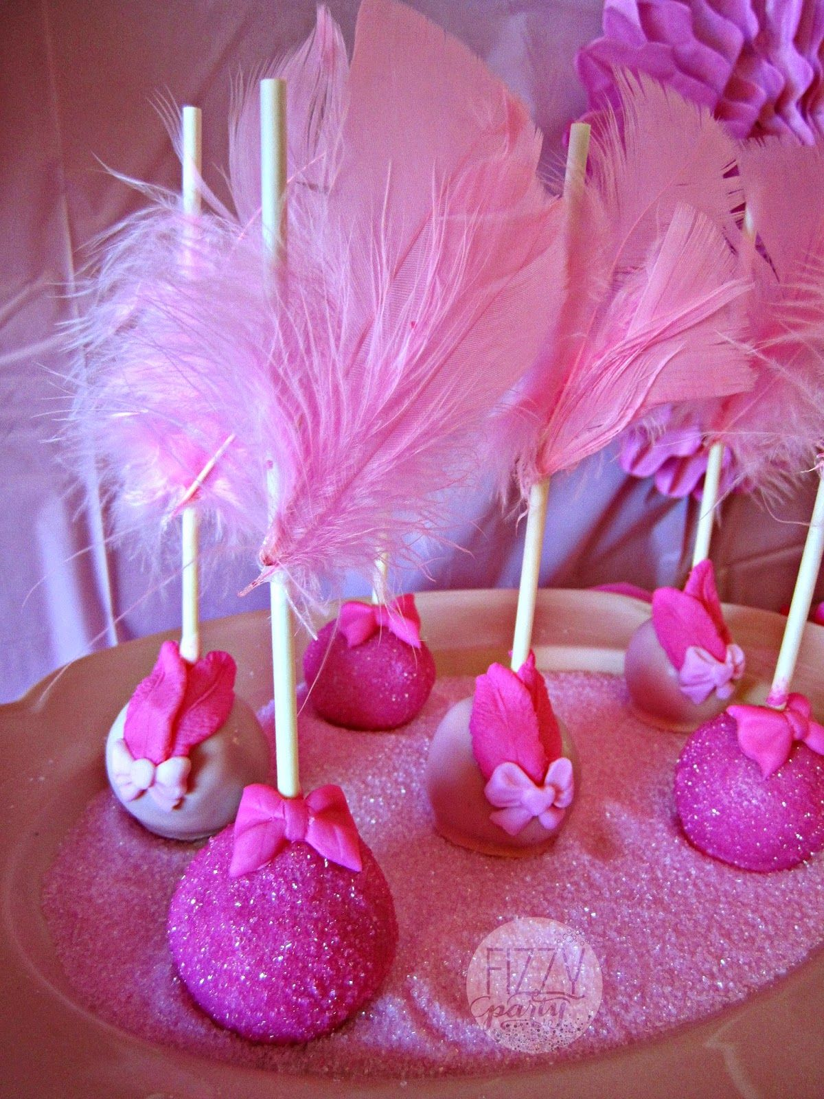 Pink party cake pops by Kima Konfections Platter rented from