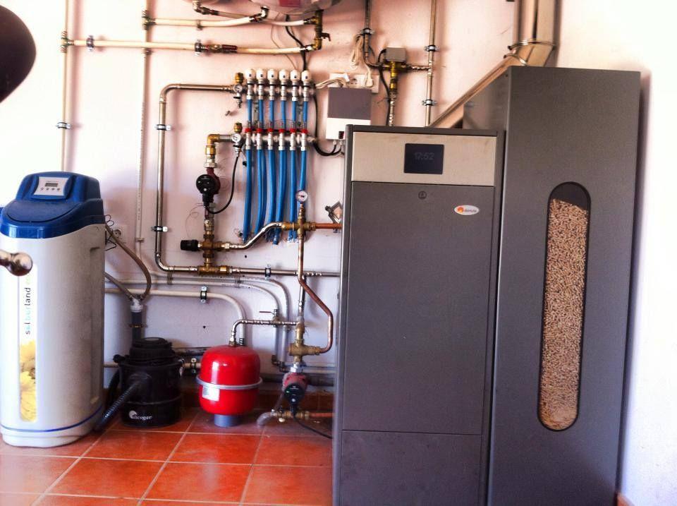 Caldera de pellet de limpieza autom tica domusa bioclass - Suelos radiantes por agua ...