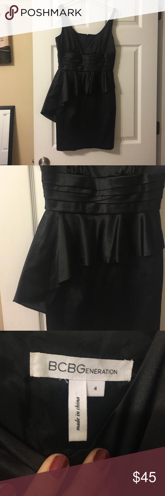 BCBGeneration Asymetrical Peplum Dress Black Satin dress with an asymmetrical peplum from BCBGeneration - size 4. BCBGeneration Dresses
