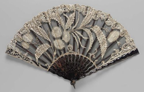 Fan (1880-90) with Belgian point lace appliquéd to black net leaf, embroidered with steel sequins. Design of thistles and heather.'   Image and text courtesy MFA Boston.