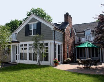 Grey Siding White Trim Black Roof And Shutters Red Brick