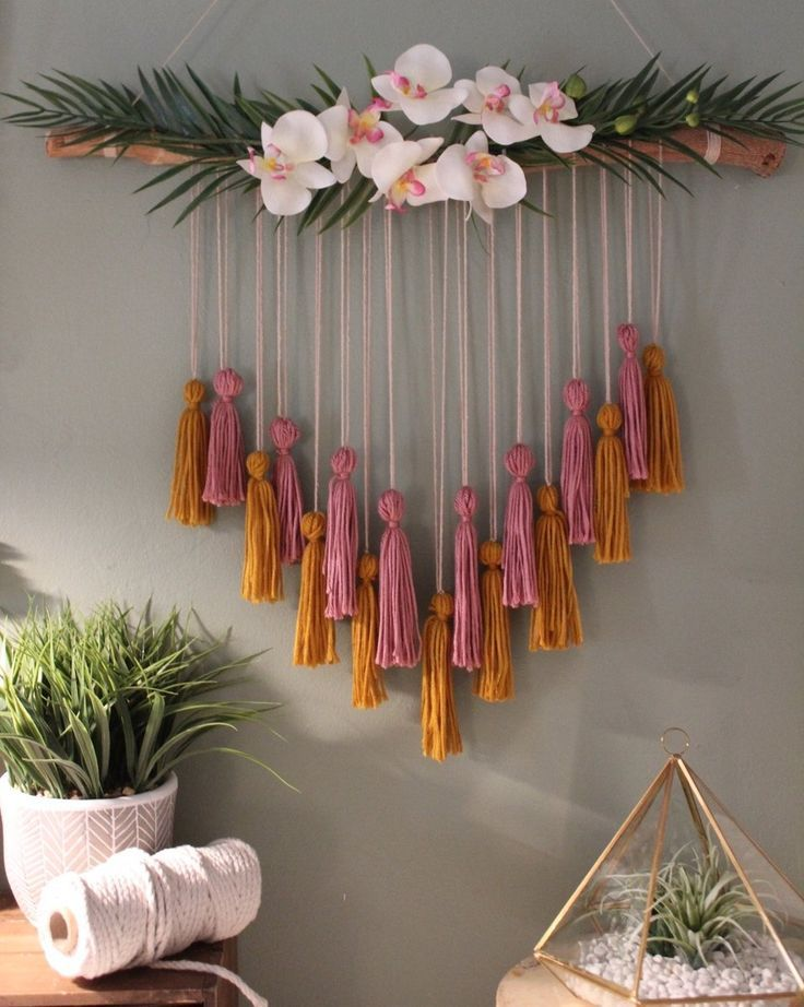 This tropical orchid tassel is ideal for any girls bedroom or boho themed wedding/party. Its birchwood foundation was carefully cut and sanded for a smooth natural finish. Hemp twine is wrapped around both ends for the use of hanging. Small pink and yellow yarn tassels were made and tied to the bottom of the twine to a