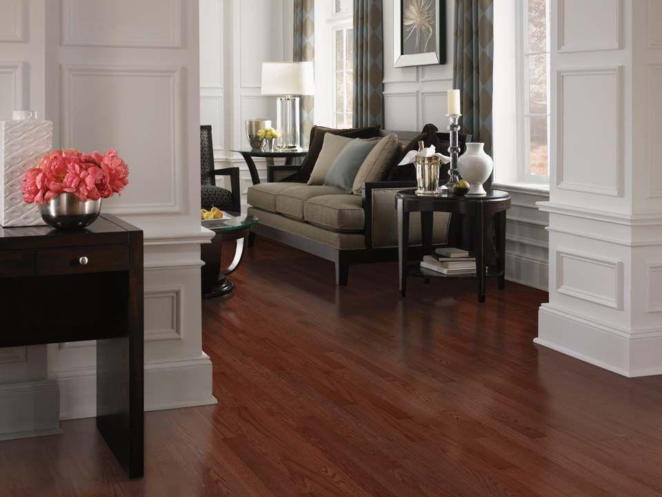 Cherry oak hardwood floors and custom molding adorning the