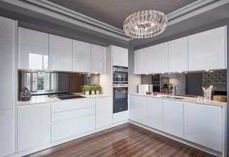 SieMatic S3 kitchen in Lotus White gloss finish, Siemens appliances, medium Timber flooring, smoked mirrored glass splashback, Farrow & Ball Plummett paint, yellow feature wallpaper and furniture. Kitchen inspiration, designed by Grid Thirteen Luxury Kitchens and Living. Leeds, West Yorkshire.