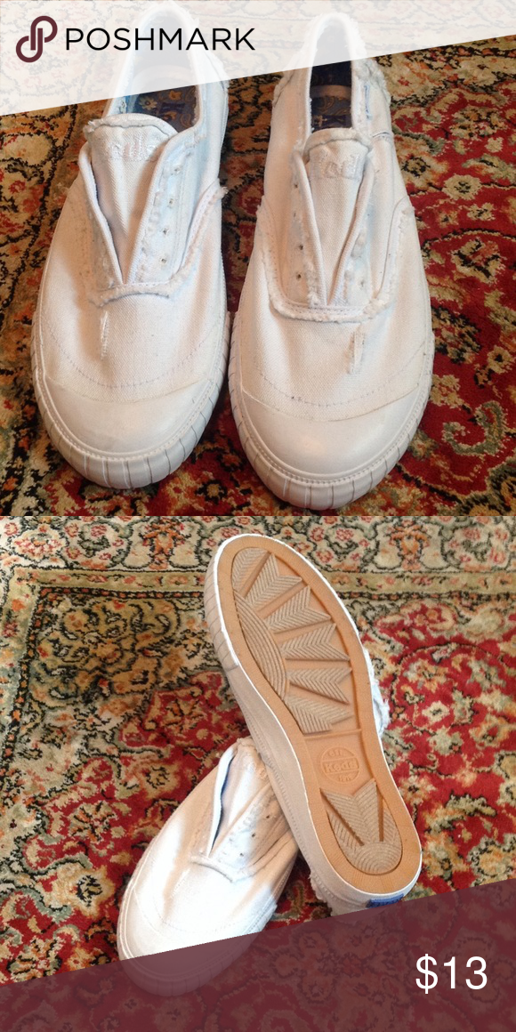 Keds slip on distressed sneakers Cute Keds distressed slip on sneakers. Only worn a couple of times. Clean, great condition! Keds Shoes Sneakers