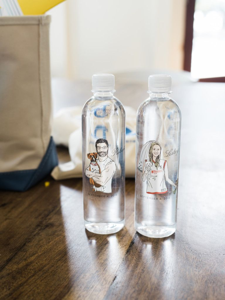 Custom bride and groom illustrations on water bottles in guest ...