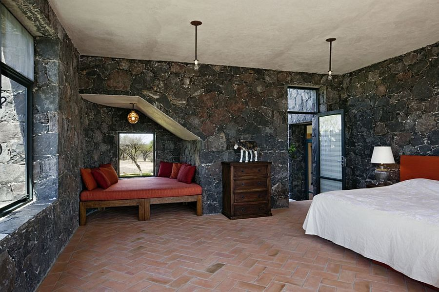 Mediterranean bedroom showcases terracotta tiles and dark stone ...