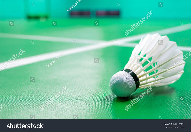 Cream White Badminton Shuttlecock And Neon Light Shading On A Green Floor Indoor Badminton Court Badminton Sport Shuttlecocks Neon Lighting Sports Wallpapers