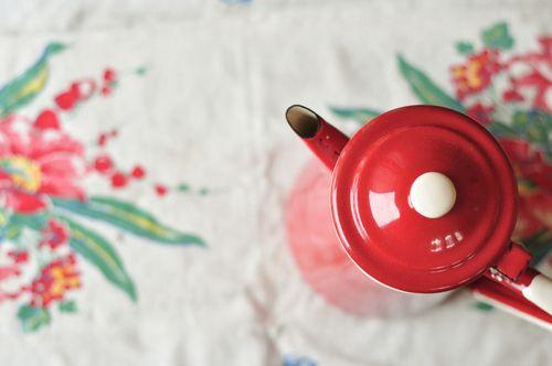 Red enamelware tea pot
