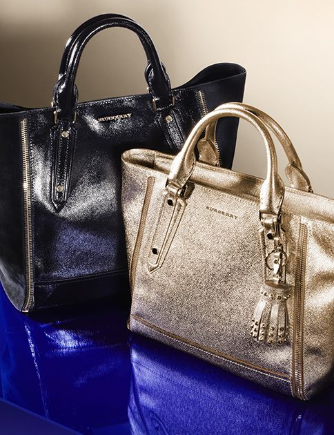 Structured tote bags in lustrous patent and soft metallic leather with studded tassel charm detail