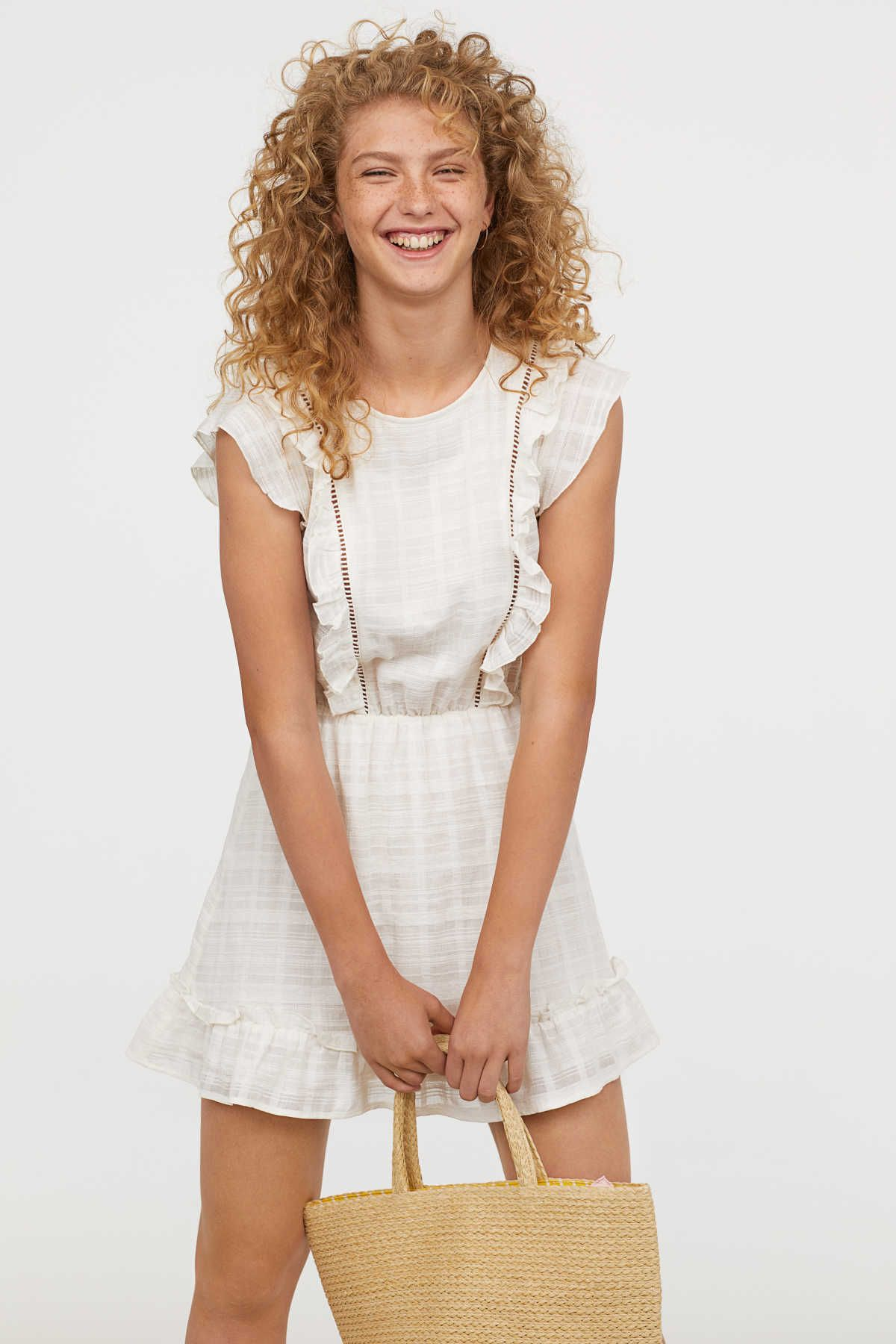 White short dress in airy woven cotton fabric with ruffles and