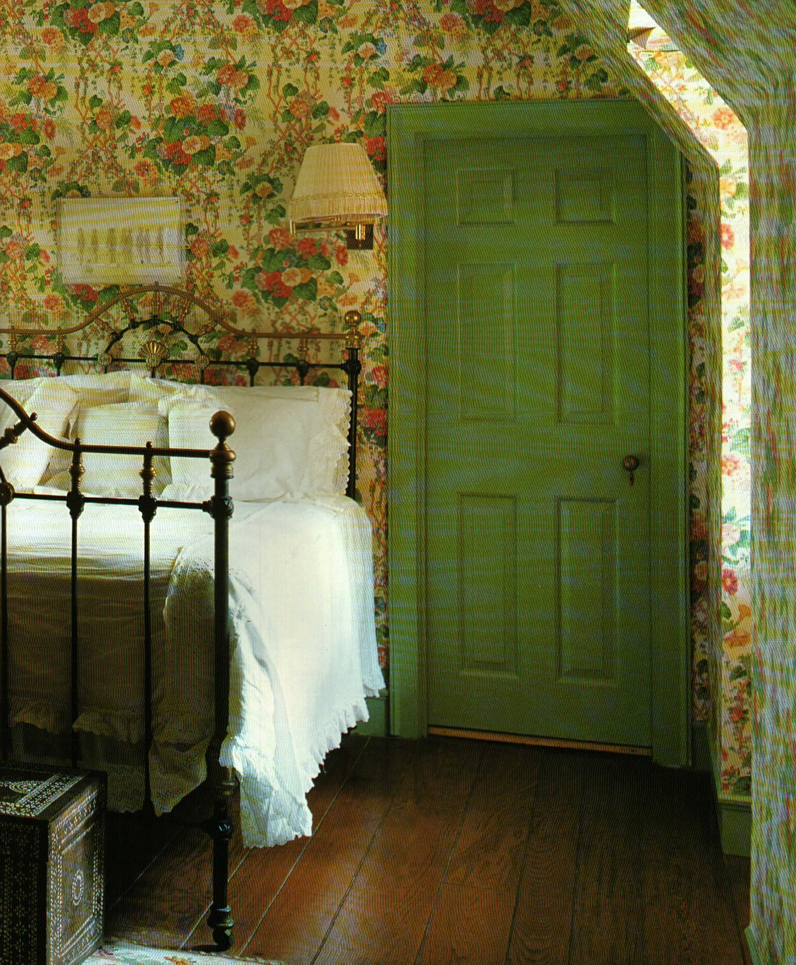 Country Cottage Bedrooms: Green Door, Floral Wallpaper, And Iron Bed At The Quaint