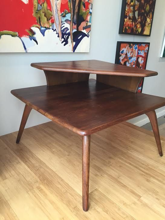 This sleek Danish coffee table has beautiful clean lines and will add sophistication to any room. Its made out of solid teak wood and is in a