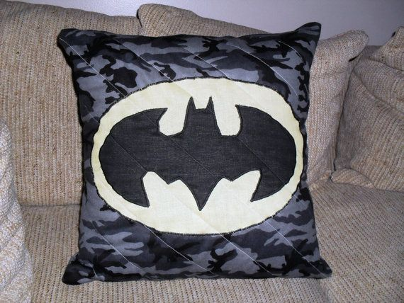 Superhero pillows are very popular. Here is the classic batman symbol on a pillow with a soft grey camouflage background.