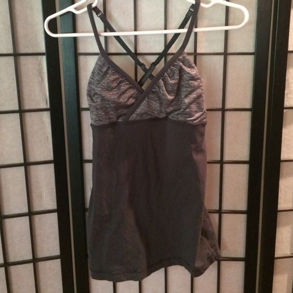 Lululemon top Grey workout tank top with crossed back,. Love it but it is too small on me lululemon athletica Tops