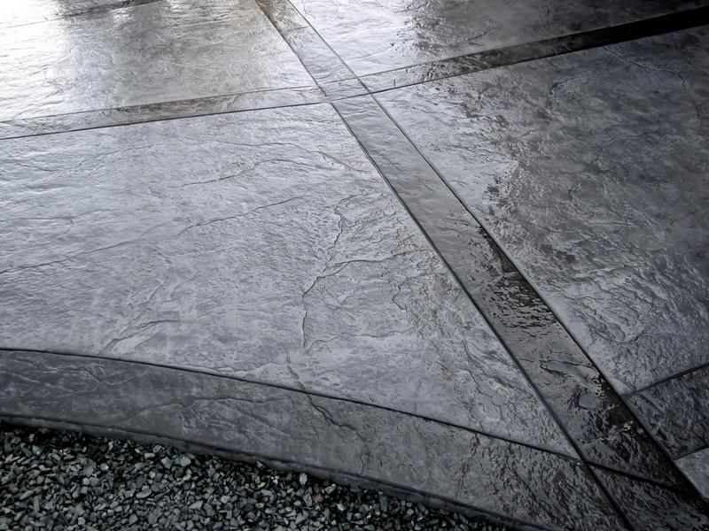 Stamped texture concrete patio gray with black grey for Black stains on concrete