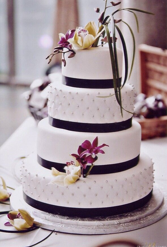 classical white wedding cake with black ribbon accent by. Black Bedroom Furniture Sets. Home Design Ideas