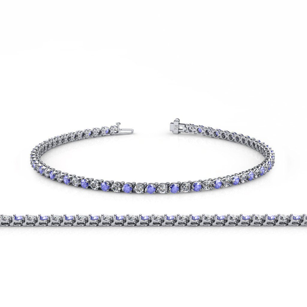 Tanzanite and Diamond (SI2-I1, G-H) 2.4mm 3-Prong Tennis Bracelet 2.85 ct tw in 14K White Gold. 29 Round Diamond of 1.45 ct tw & 28 Round Tanzanite of 1.40 ct tw set using 3-Prong Setting. SI2-I1-Clarity, G-H-Color Diamond. Gemstones may have been Treated to Improve their Appearance or Durability & may Require Special Care. The Natural Properties & Composition of Mined Gemstones define the Unique Beauty of each Piece. The Image may show Slight Differences to the Actual Stone in Color &...