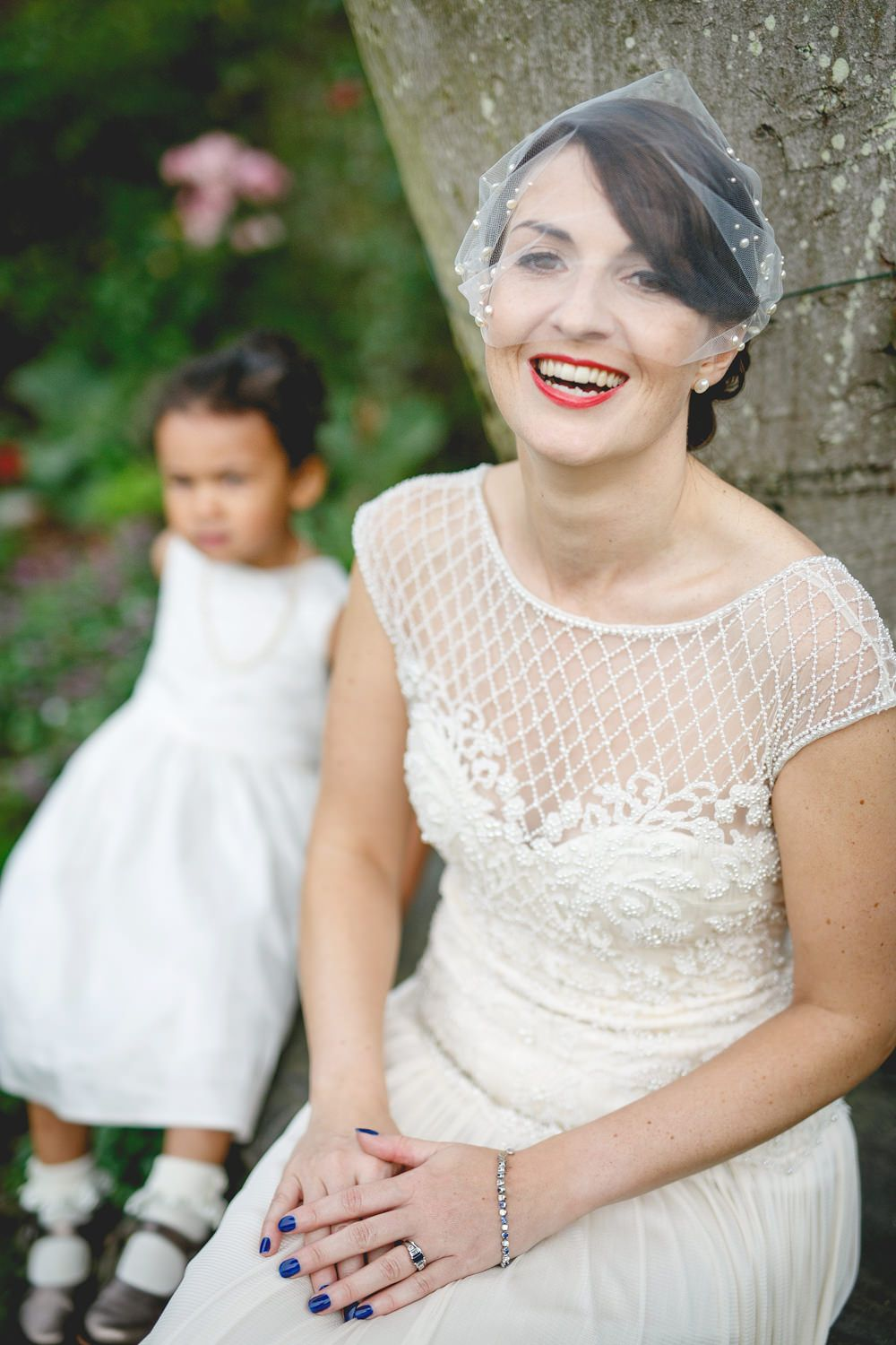 Mavric Photography - A Catherine Deane gown for a back garden wedding in Essex with a white colour theme and photography by Mavric Photography.