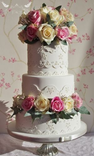 Romeo & Juliet Cakes - Giovanna white Wedding Cake with broderie anglaise, buttwry yellow and pink roses and eucalyptus