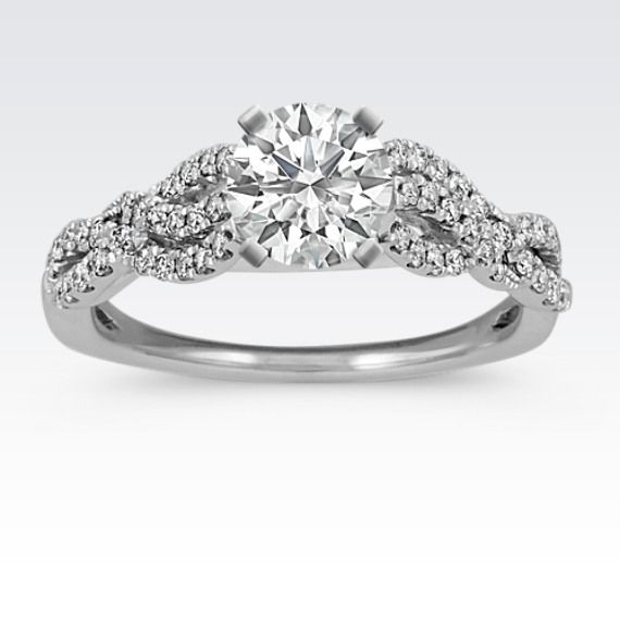 Contemporary swirl engagement ring with so much sparkle!