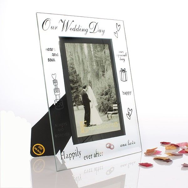 This gorgeous glass frame is decorated with lots of different words and small pictures that we associate with marriage including hearts, rings and the words Happily Ever After.