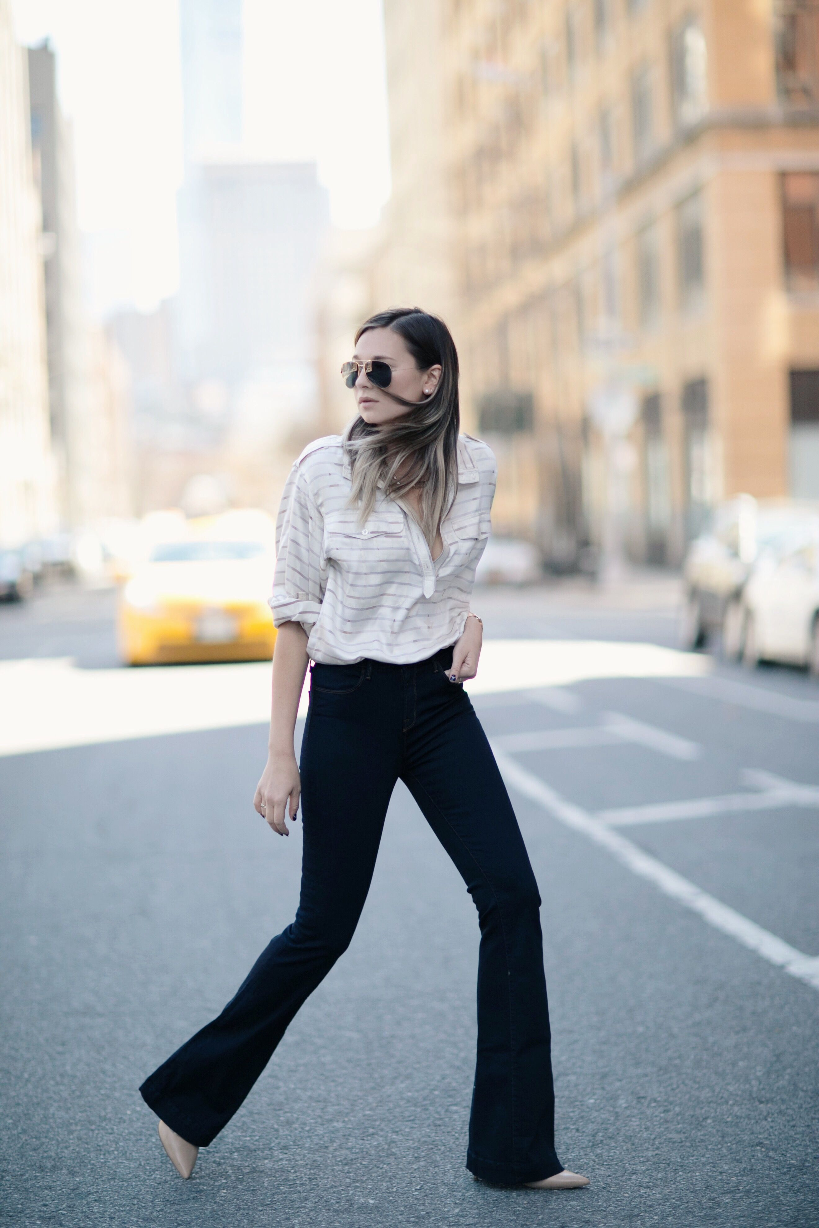 Danielle Bernstein of We Wore What in a striped top tucked into flared jeans