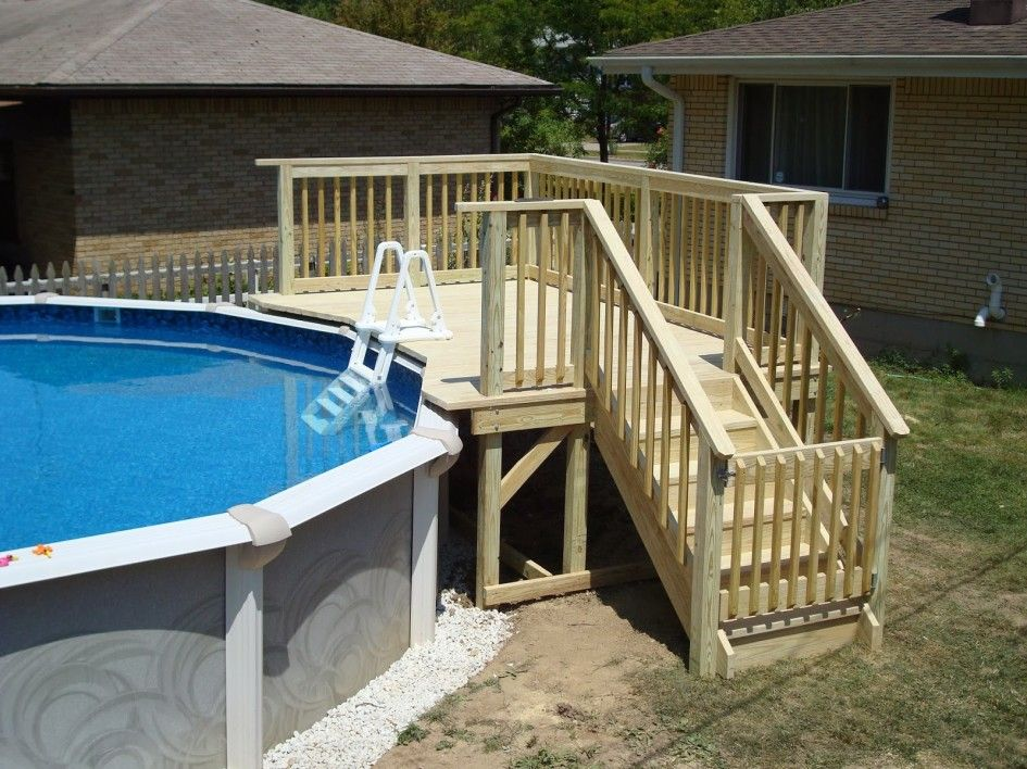 Cool above ground pool decks ladder pool deck for Deck from house to above ground pool
