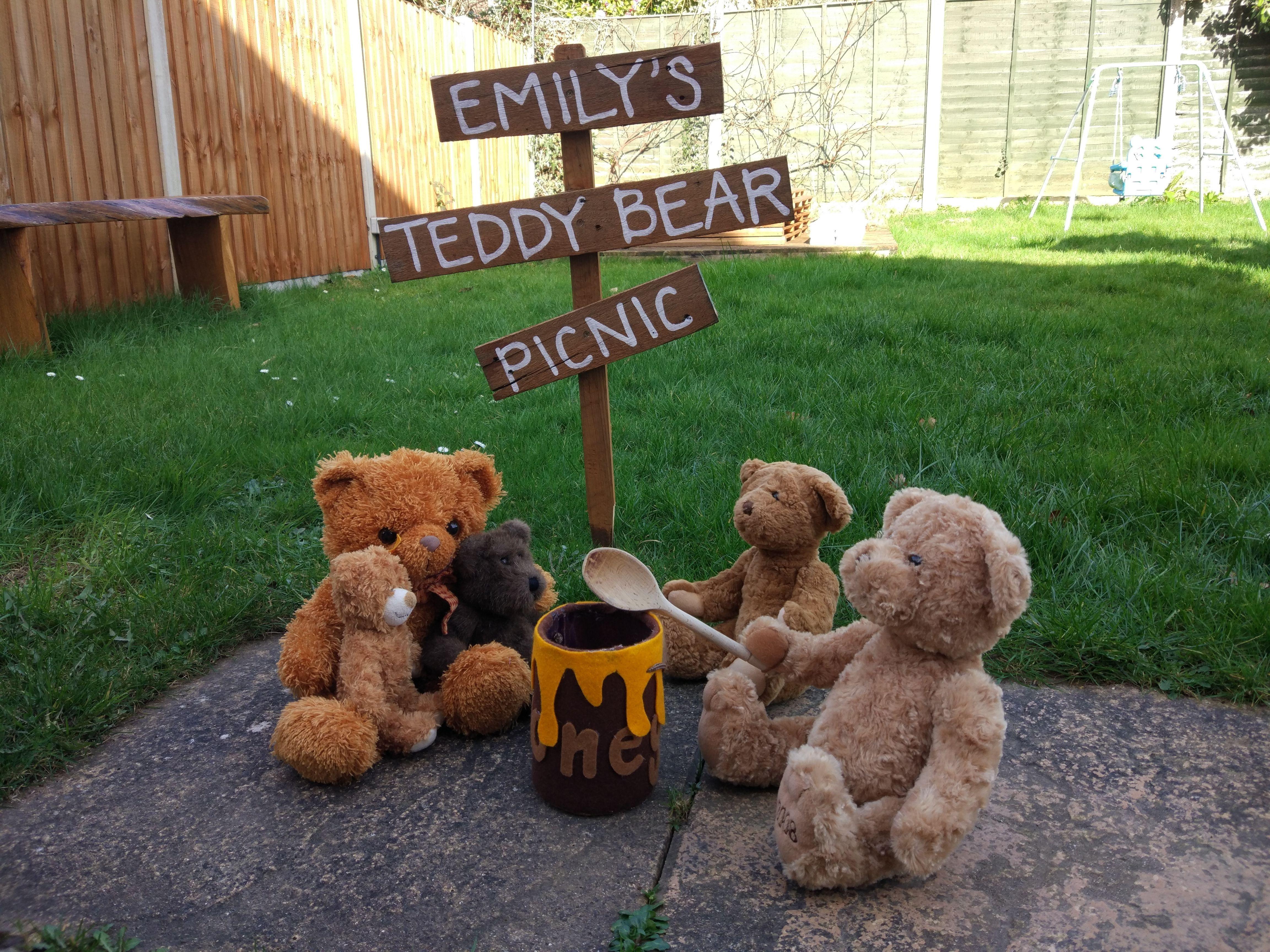 A family of Teddy Bears sat round the honey pot at Emily's Teddy Bear Picnic....so cute! #babyteddybear