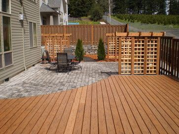 wood deck that steps down to paver patio curved deck design