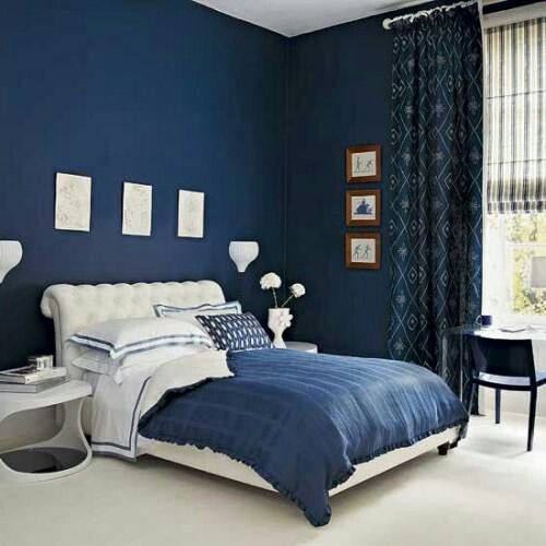 Navy Walls With Patterned Curtains For Bedroom