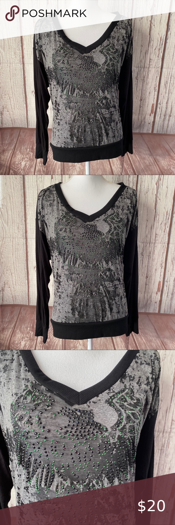 Daytrip long sleeve top size large Blingy Daytrip long sleeve top green and black iridescent detail material 50% polyester 35% Cotton 15% rayon approximate measurements Pit to pit measures 21 inches length measures 24.5 inches 0067-4781-1120-10 Daytrip Tops Tees - Long Sleeve