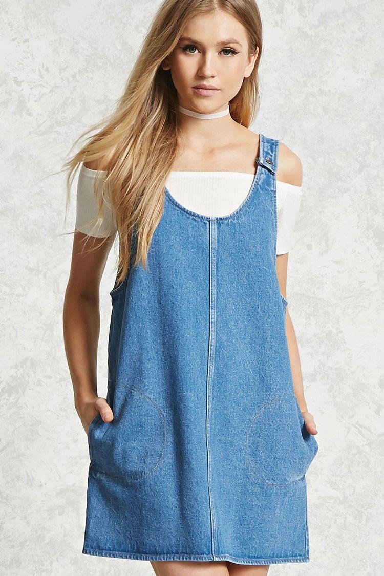 81bcca042e4 A denim overall dress featuring button shoulder straps