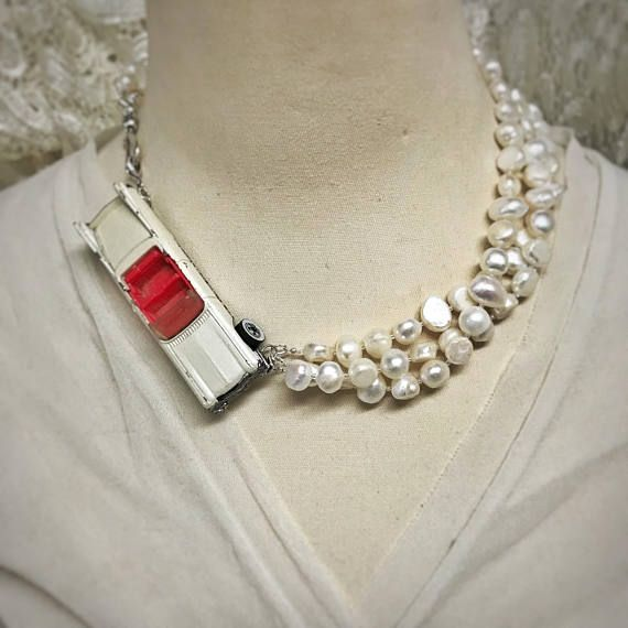 This white Cadillac assemblage necklace is so fun!! It has a vintage toy car (looks like an old Cadillac to me, but could be a 57 Chevy, or something else for all I know...) paired with 3 strands of big approximately 9mm rustic freshwater pearls. The combination is smashing! The