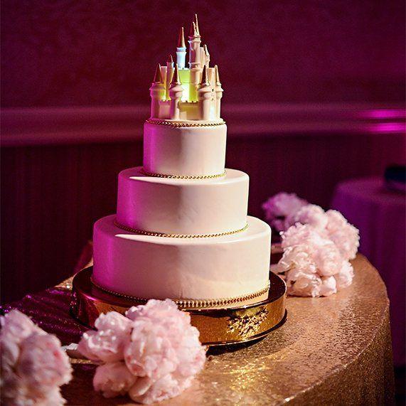 Wonderful #weddingcake with a magical touch! Love the #uplighting highlights!Great photo via #DisneyWedding