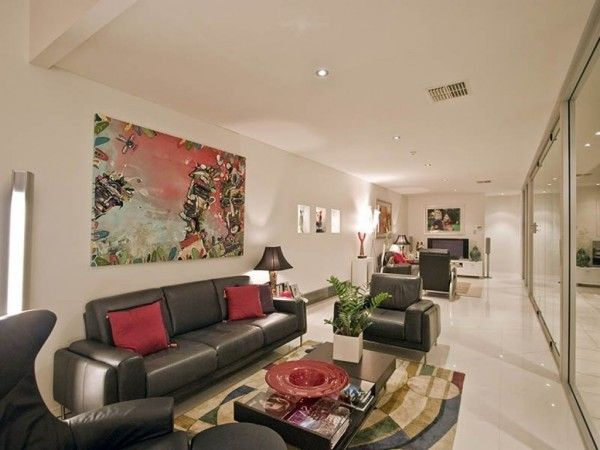 Long Narrow Living Room With White Walls And Wall Art Idea Black