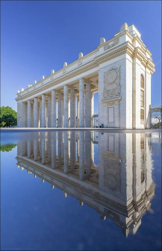 "Reflection of Gorky Park Main Entrance - Moscow | Russia  ""The main entrance to the park erected in 1955 by architect George (Yuri) Vladimirovich Schuko.""  Photographer : Yuri Degtyarev https://www.flickr.com/photos/38465352@N03/"