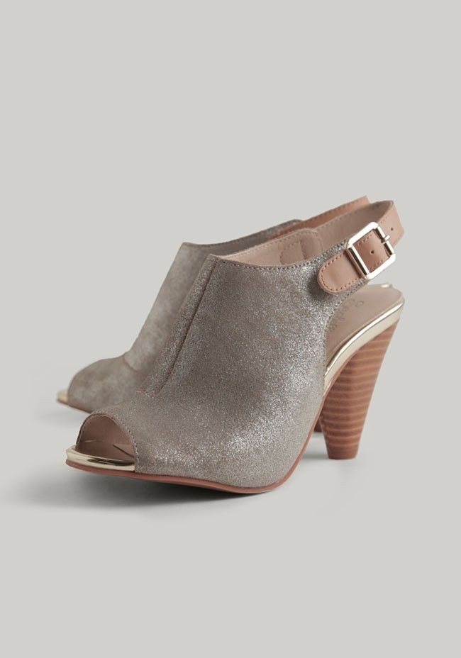 80f1f8df6a8b Add a touch of glamour to your ensemble with these metallic silver-toned  booties featuring open-toes and stacked heels. Finished with tan-colored  adjustable ...