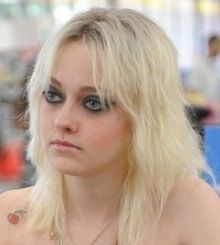 Dakota Fanning as Cherie Carrie in the 2009 (2010?) film about the Runaways.  Love her hair.