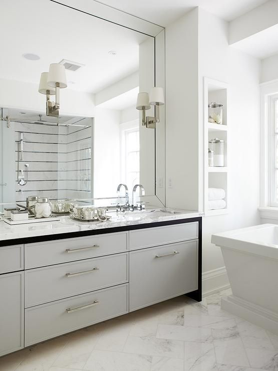 White And Gray Bathroom Features A Gray Dual Washstand Topped With White Marble Fitted W Large Bathroom Mirrors Bathroom Mirror With Shelf Mirror Wall Bathroom