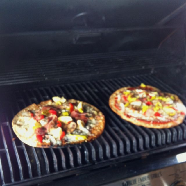 Costco thin crust pizza dough, grill one side, place favorite toppings on grilled side of pizza, return to grill for another 5 minutes on medium heat, serve! Easy mmm!
