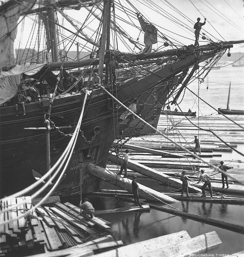 Loading ship with square timber through the bow port, Quebec City, QC, 1872