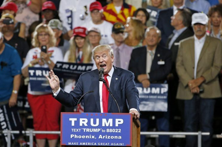 """Donald Trump speaks at a rally Saturday, June 18, 2016, in Phoenix.  PHOENIX, Ariz. — Donald Trump issued a warning on Saturday to Republicans who might be trying to undermine his candidacy at next month's GOP convention, insisting it wouldn't be """"legal"""" for his opponents to block him from the party'"""