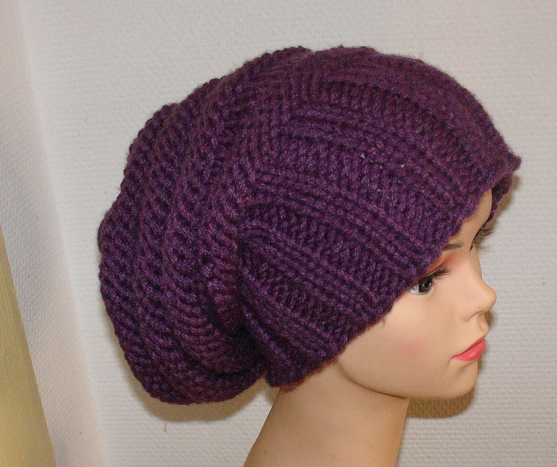Knit slouch hat style. Looks like a 2x2 rib and stockenette/reverse ...