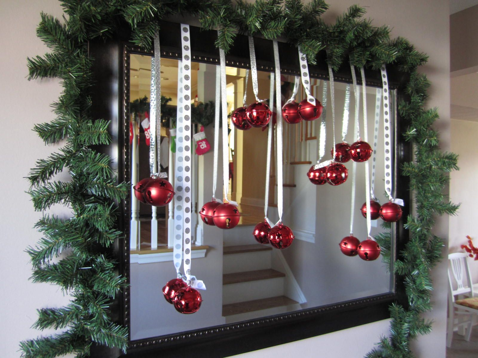 LOVE this idea! Hanging decorations in front of or on a mirror. i put a big wreath on my mirror and it looks amazing!