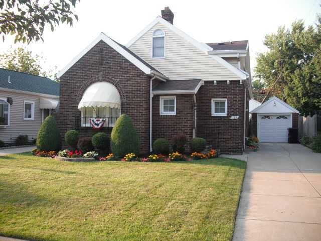 MJ Peterson Real Estate -- 165 Ferndale Ave. TONAWANDA NY -- Old World Charm with updated conveniences! Exterior is something out of a fairytale with arched windows & cheery yellow awnings. A backyard professionally designed & maintained, water feature included for a relaxing setting. First floor boasts 2 bedrooms & gleaming hardwood floors, a spacious living room with a very unique wood burning fireplace. 2nd floor is a master suite with jacuzzi tub & huge walk-in closet. The basement…