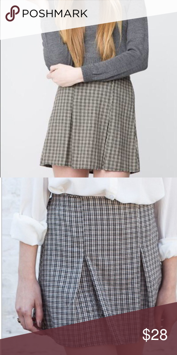 a738e3e7eb Brandy Melville Kaitlee Skirt Brandy Melville plaid Kaitlee Skirt. Black  and pale yellow/cream color. Stretchy back waistband and pleated front.