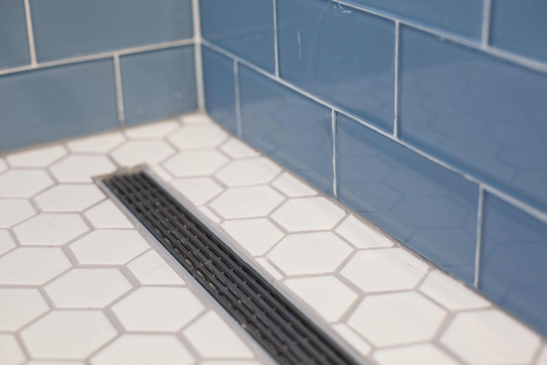 Infinity shower drain with white hexagon bathroom tile. | Linear ...